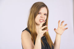 Agressive woman wants to strangle somebody Stock Photography