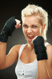 Agressive young beautiful blond boxer girl Royalty Free Stock Image