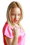 Agressive young blondy. Portrait of agressive young blondy showing her fist Royalty Free Stock Images