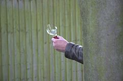 Agressor in hiding. Hand holding a broken glass bottle for offence or defence Stock Image