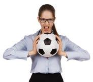 Agresywna dziewczyna z piłki nożnej piłką Obraz Stock