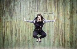 Agresywna kobieta skacze Zdjęcie Stock