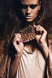 Agresywna kobieta z akcesorium rożek Obrazy Royalty Free