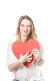 Agresywna przyglądająca dziewczyna z wielkim sercem Obraz Royalty Free