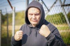 Agresywni mężczyzna wezwania dla walki Obraz Royalty Free
