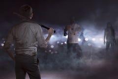 Agresywny biznesmen widzii żywych trupów z kijem bejsbolowym Zdjęcie Royalty Free