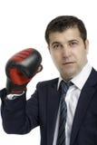 Agresywny biznesmen z bokserskimi rękawiczkami Fotografia Royalty Free