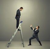 Agresywny biznesmen z megafonem Fotografia Royalty Free