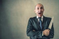 Agresywny biznesmen z nożem Zdjęcie Stock