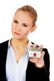 Agresywny biznesowej kobiety miażdżący mały dom Obrazy Royalty Free