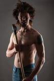 Agresywny brudzi mężczyzna z ax w rękach Zdjęcie Royalty Free