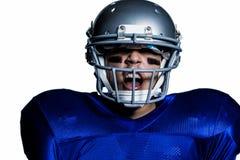 Agresywny futbolu amerykańskiego gracz Obrazy Stock