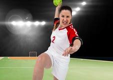 Agresywny gracz bawić się handball w stadium Obraz Royalty Free