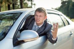 Agresywny kierowca jadący narzeka podczas gdy Obraz Royalty Free