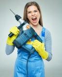 Agresywny kobieta budowniczy z puncher narzędziem Fotografia Stock