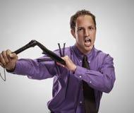 Agresywny mężczyzna z czarnym batem Zdjęcia Stock