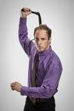 Agresywny mężczyzna z czarnym batem Fotografia Royalty Free