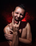 Agresywny młody człowiek Fotografia Stock
