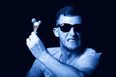Agresywny młody człowiek z lizakami w ręce Fotografia Royalty Free