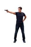 Agresywny młody człowiek z pistoletem odizolowywającym na bielu Zdjęcie Royalty Free