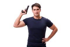 Agresywny młody człowiek z pistoletem odizolowywającym na bielu Zdjęcia Royalty Free