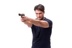 Agresywny młody człowiek z pistoletem odizolowywającym na bielu Obraz Royalty Free