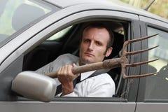 Agresywny męski kierowca w jego samochodzie Zdjęcia Stock