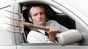 Agresywny męski kierowca w jego samochodzie Obrazy Stock