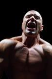 Agresywny mięśniowy mężczyzna Obrazy Royalty Free