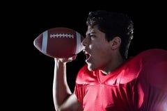 Agresywny sportowiec z piłką Zdjęcie Royalty Free