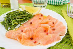 Agretti appetizer with salmon Stock Image