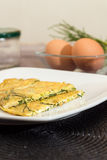 Agretti omelets. Agretti omelet with fresh ingredients in the background Royalty Free Stock Photography