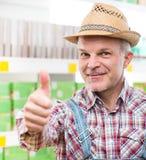 Agricoltore ai pollici del supermercato su Immagini Stock