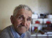 Agricoltore anziano dell'interno Fotografia Stock