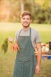 Agricoltore bello che sorride alla macchina fotografica Immagine Stock Libera da Diritti