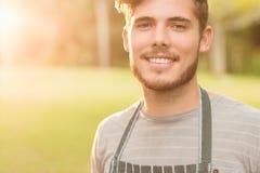 Agricoltore bello che sorride alla macchina fotografica Fotografia Stock Libera da Diritti