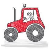 Agricoltore che guida un trattore Fotografie Stock