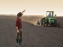 Agricoltore con il trattore Fotografia Stock