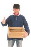Agricoltore con la cassa isolata sopra fondo bianco Fotografia Stock