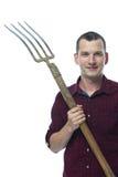 Agricoltore con una forca su un fondo bianco Fotografia Stock