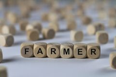Agricoltore - cubo con le lettere, segno con i cubi di legno Immagini Stock Libere da Diritti