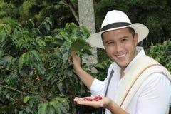Agricoltore del caffè nei campi fotografia stock