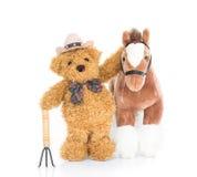 Agricoltore dell'orsacchiotto con la forca ed il cavallo Immagini Stock