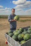 Agricoltore ed anguria Fotografia Stock