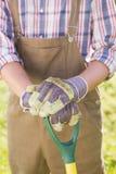 Agricoltore felice con la sua pala Fotografia Stock Libera da Diritti