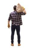 Agricoltore maschio che tiene un sacco della tela da imballaggio sulla sua spalla Immagine Stock