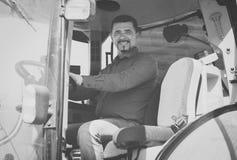 Agricoltore maturo in trattore Fotografia Stock Libera da Diritti