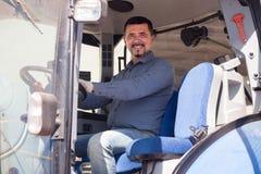 Agricoltore maturo in trattore Immagine Stock Libera da Diritti
