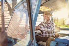 Agricoltore senior su un trattore Fotografia Stock Libera da Diritti