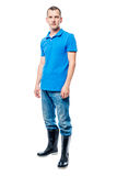 Agricoltore in stivali di gomma e jeans in integrale su un bianco Fotografie Stock Libere da Diritti